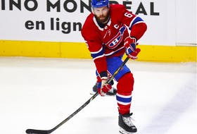 Canadiens Shea Weber moves the puck up ice during first period against the Calgary Flames in Montreal on April 14, 2021.