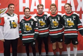 Halifax Mooseheads captain Elliot Desnoyers, far right, poses with, from left to right, CFB Halifax base commander Sean Williams and assistant captains Zach Beauregard, Stephen Davis and Zachary L'Heureux.