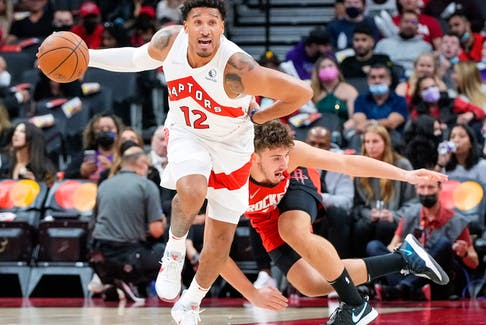 Raptors forward Ish Wainright moves the ball up the court against the Rockets in pre-season action. Wainright will find out in the next week if he's made the team.