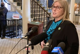 Karla MacFarlane, minister of L'nu affairs, speaks to reporters at Province House in Halifax on Thursday, Oct. 14, 2021.
