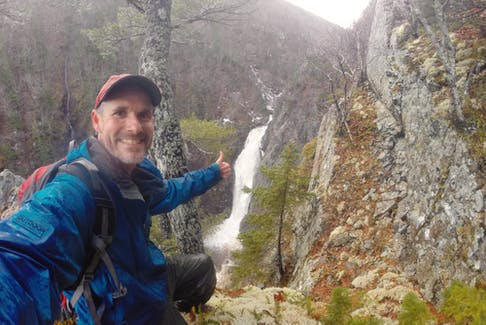 Benoit Lalonde, seen here in front of the French River Falls in Nova Scotia, is the author of Waterfalls of Cape Breton Island: A Guide.