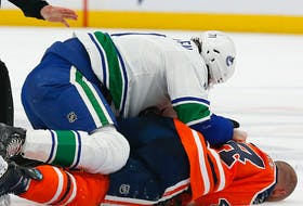 Edmonton Oilers forward Zack Kassian (44) is injured during a fight with Vancouver Canucks forward Zack MacEwen (71) at Rogers Place on Thursday, Oct. 7, 2021.