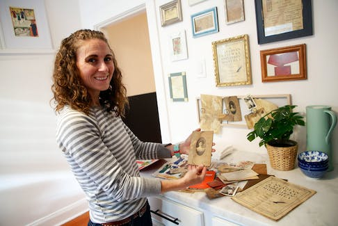 """FOR DEMONT: Sarah Worford (sp?)  looks through some of the """"artifacts"""" found in the walls of their home in Halifax Thursday October 14, 2021.  SEE DEMONT STORY FOR DETAILS  TIM KROCHAK PHOTO"""