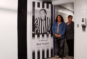 Lori Morrison and Kathi MacConnell helped to repaint Hector Arena's referee room.