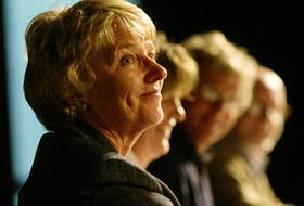 NDP incumbent Alexa McDonough smiles as she is asked a question seated next to Liberal candidate Sheila Fougere, Green party candidate Michael Oddy and Conservative candidate Kevin Keefe during a 2004 campaign debate at Dalhousie University in Halifax.