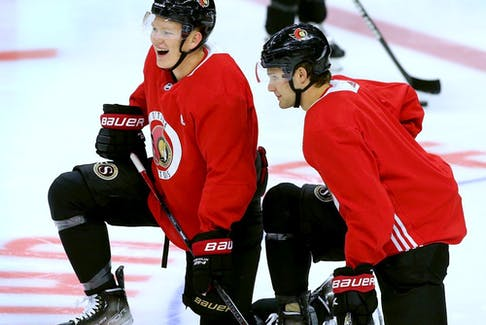 After finally being signed for a $57.5 million, seven-year contract, Brady Tkachuk (left) was on the ice for practice Friday with his Ottawa Senators teammates at Canadian Tire Centre.