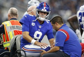 New York Giants quarterback Daniel Jones leaves the field on a cart with an injury in the second quarter against the Dallas Cowboys.