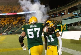 Edmonton Elks receiver Shai Ross (11) celebrates a touchdown against the Winnipeg Blue Bombers with centre David Beard (57) at Commonwealth Stadium in Edmonton on Friday, Oct. 15, 2021.