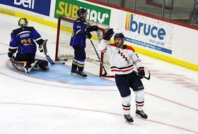 Acadia Axemen forward Nick Deakin-Poot celebrates after scoring a shorthanded goal during the second intermission of the Oct. 15 game with Moncton.