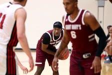 Isolation shot of Saint Mary's Huskies basketball players Johneil Johnson for Glenn MacDonald.