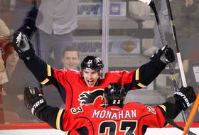 Calgary Flames Mikael Backlund celebrates his goal on the Minnesota Wild with teammate Sean Monahan. THe Pair are among 4 temporary co-captains for the Flames.