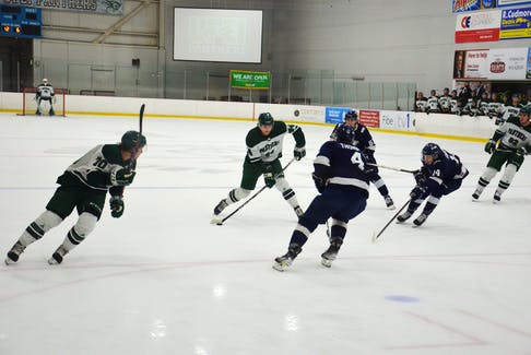 UPEI Panthers defenceman Matt Brassard, 44, releases a shot as teammate Drake Pilon, 70, races down the right-wing. The St. Francis Xavier X-Men's William Thompson, 4; Dallas Farrell, 14, and Sam Allison, 61, defend. UPEI pulled out a 4-3 win in the Atlantic University Sport men's hockey contest at MacLauchlan Arena on Oct. 15.