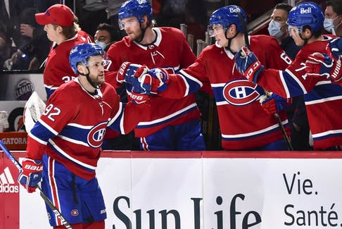 Canadiens' Jonathan Drouin (92) celebrates his goal with teammates on the bench against the New York Rangers during the third period at the Centre Bell on Saturday, Oct. 16, 2021, in Montreal.