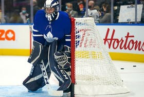 Toronto Maple Leafs goaltender Alexander Bishop (70) warms up before the start of a game against the Ottawa Senators.. The Maple Leafs signed the University of Toronto player to a one-day amateur try out as a backup goaltender.