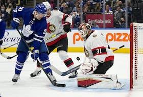 Ottawa Senators goaltender Anton Forsberg makes a save on Toronto Maple Leafs forward Nick Ritchie.