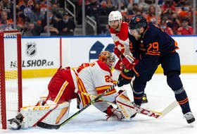 Edmonton Oilers' Leon Draisaitl (29) is stopped by Calgary Flames goaltender Jacob Markstrom (25) during first period NHL action at Rogers Place in Edmonton, on Saturday, Oct. 16, 2021.