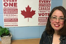 Christina McKay, a Halifax high school teacher, is seen with a Student Vote poster behind her. McKay says fixed summer provincial elections will greatly reduce the impact of the Student Vote program in Nova Scotia schools.