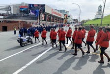 RCMP offcers march toward the Scotiabank Centre and Citadel Hill in Halifax on Sunday in the 39th annual Peace Officers Memorial Service.