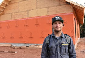 Brodye Chappell outside what will become his new workshop. The furniture maker is happy to see the prices of lumber come down, but hardwood prices continue to be high, forcing him to pass those increases onto his customers.