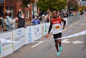 Dennis Mbelenzi of Halifax crosses the finish line in the Prince Edward Island Marathon on Oct. 16. Mbelenzi set a new record if two hours 30 minutes 23 seconds (2:30:23) for the 42.2-kilometre full marathon.