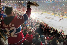 Canadiens fans cheer on the team during pre-game warmup Saturday night at the Bell Centre.
