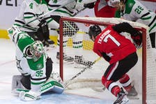 Senators winger Brady Tkatchuk (7) looks for a loose puck following a save by Stars goalie Anton Khudobin (35) during the last meeting between the two teams in February 2020. Tkachuk re-signed with the Senators on Thursday, but as of Saturday was not expected to make his season debut until later this coming week.