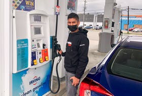 Urvesh Boodhun fuels up at a Sydney service station. The Charlottetown resident needed to top off the tank after spending the weekend touring Cape Breton. Like other drivers utilizing area self-serve pumps, Boodhun paid $1.45.9 per litre. DAVID JALA/CAPE BRETON POST