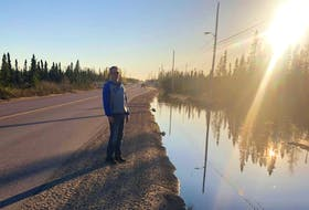 Brad Keats standing on Kelland Drive, directly behind their home in Happy Valley-Goose Bay.