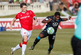Cory Bent of the HFX Wanderers battles with Tom Field of Cavalry FC during Sunday's Canadian Premier League match at ATCO Field in Calgary. - Tony Lewis / CANADIAN PREMIER LEAGUE
