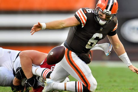 Baker Mayfield #6 of the Cleveland Browns fumbles the ball after a tackle from J.J. Watt #99 of the Arizona Cardinals during the third quarter at FirstEnergy Stadium