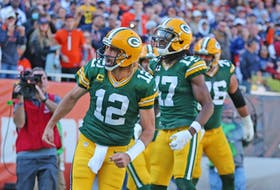 Green Bay Packers quarterback Aaron Rodgers (12) celebrates scoring a touchdown during the second half against the Chicago Bears at Soldier Field.
