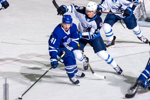 That the Toronto Marlies tabbed Jeremy McKenna (41) to promote from the Newfoundland Growlers when they found themselves in need of a forward wasn't surprising; the 22-year-right-winger from Summerside, P.E.I., appeared in 28 games for the Marlies last season, including this May contest against Jeff Mallot (39) and the Manitoba Moose in Toronto. — Toronto Marlies photo/Christian Bonin/TSGphoto.com