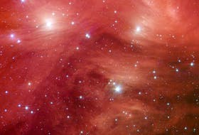 The Seven Sisters, also known as the Pleiades star cluster, seem to float on a bed of feathers in a 2007infrared image from NASA Spitzer Space Telescope. Clouds of dust sweep around the stars, swaddling them in a cushiony veil. - NASA