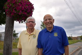 The New Waterford Rotary Club purchased 27 hanging flower baskets that lined Plummer Avenue during the summer and fall, as part of the club's beautification program. The flowers were purchased from Gerard Burke, who also maintained the flowers. The beautification program is one of several things the club does for the community each year. Members of the club are shown with a flower basket, from left, Duncan Roach and Roger Guyaux. JEREMY FRASER • CAPE BRETON P