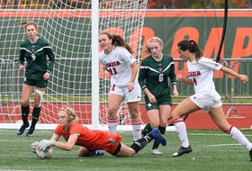 Cape Breton University keeper Haley Kardas pounces on a rebound late in the game to preserve the Capers 2-1 victory over Acadia Axewomen in Atlantic University Sports women's soccer action Sunday at the Cape Breton Health Recreation Complex. CONTRIBUTED • VAUGHAN MERCHANT, CBU ATHLETICS
