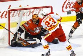 Calgary Flames forward Sean Monahan scores on Anaheim Ducks goaltender Ryan Miller at the Scotiabank Saddledome in Calgary on Feb. 17, 2020.