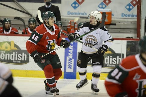 Centre Zachary Beauregard, right, harasses Halifax Mooseheads winger Zachary L'Heureux while he was a member of the Charlottetown Islanders last season. - Jason Malloy