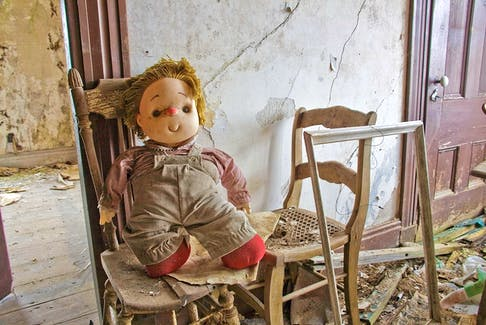 This Chucky-style vintage doll was found contorted on a wooden chair in an abandoned house. - Fred Horton