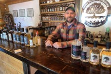 Andrew Cameron, co-owner of Still Fired, stands at the distillery's bar in Annapolis Royal.