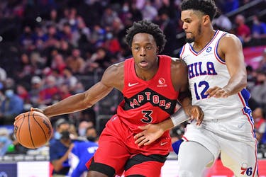 Raptors forward OG Anunoby (left) is defended by Philadelphia 76ers' Tobias Harris during the second quarter at Wells Fargo Center on Oct. 7, 2021.