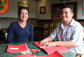 Jody Holley and her son Luke Reddick at Jungle Jim's, using the braille and QR code menus.