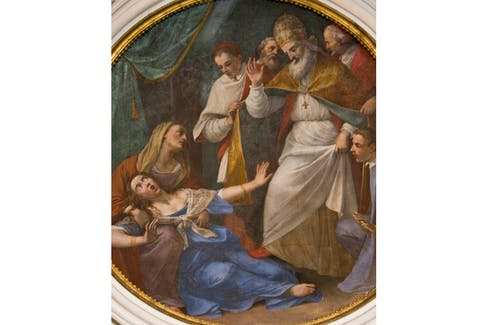 The Dominican Pope St. Pius V is shown exorcising a woman on this fresco is from the cell of St. Pius V in Santa Sabina, Rome. - Flickr Creative Commons/Lawrence OP