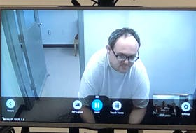 Matthew Twyne is shown on a courtroom screen during his bail hearing in August. He's scheduled to attend his sentencing next month the same way; via video from Her Majesty's Penitentiary.