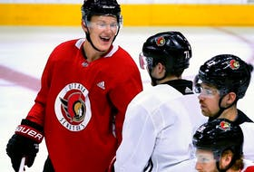 After finally being signed for a $57.5 million, seven-year contract, Brady Tkachuk (red) was on the ice for practice Friday with his Ottawa Senators teammates at Canadian Tire Centre.