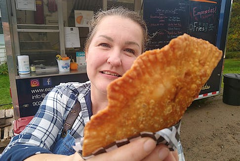 Bettina Hartenstein of South Haven stands outside her family's food truck, East Coast Empanadas, with a sample of the original Latin American street food they offer. During the Cabot Trail Food Truck Rally on Saturday and Sunday, East Coast Empanadas will be set up at the Wreck Cove General Store. Contributed