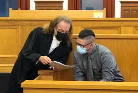 Steve Bragg (right) reviews victim impact statements by the family members of Victoria Head during a break in his sentencing hearing Tuesday, Oct. 19. Bragg has acknowledged killing Head in the early morning hours of Nov. 11, 2017.