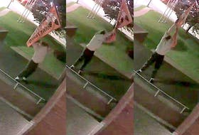 In these three images taken from video, a man rips down an Every Child Matters flag from in front of Halifax police headquarters early Saturday morning, Oct. 16, 2021.