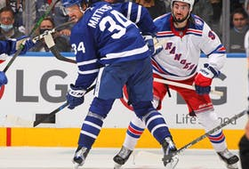 Maple Leafs' Auston Matthews watches an incoming pass while being covered by Mika Zibanejad of the New York Rangers at Scotiabank Arena on Monday, Oct. 18, 2021 in Toronto.