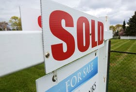 A sold sign is seen outside a house in the tourist destination of Prince Edward County, Ont.