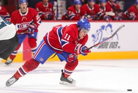Montreal Canadiens' Brendan Gallagher sidesteps a check by San Jose Sharks' Jasper Weatherby during third period in Montreal on Oct. 19, 2021.